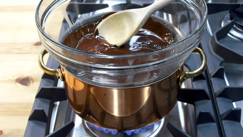 Melting Chocolate - A Bowl Over A Pan Of  Steaming Water